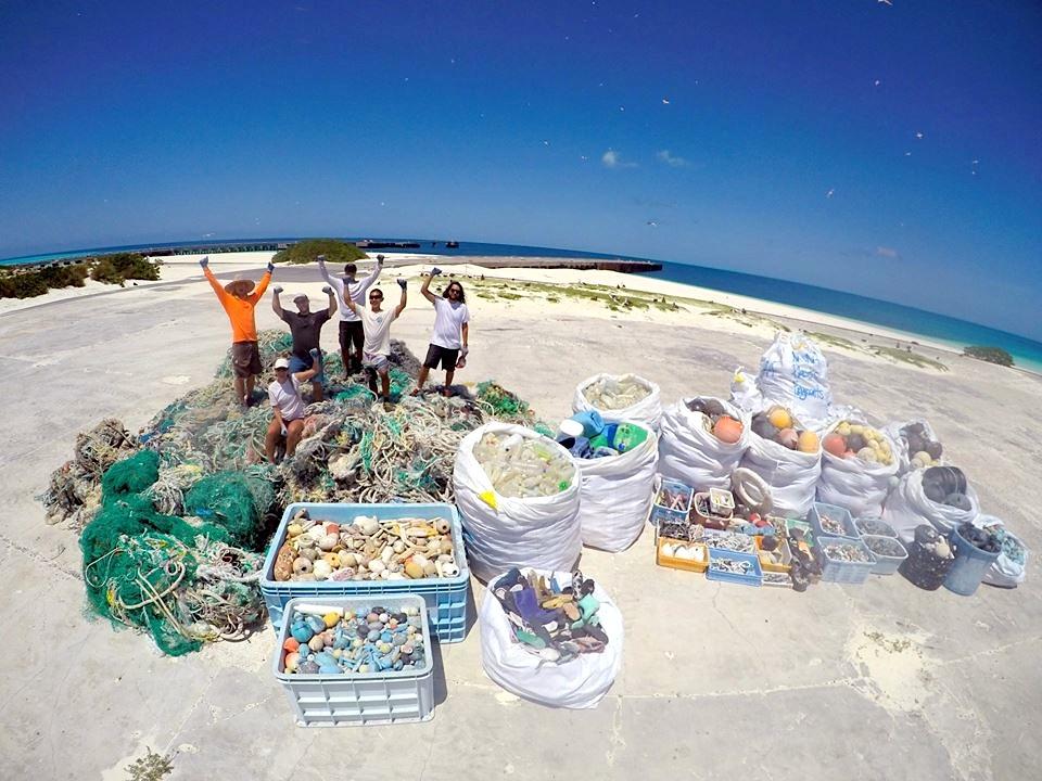 Clearing Beach Debris (NOAA)